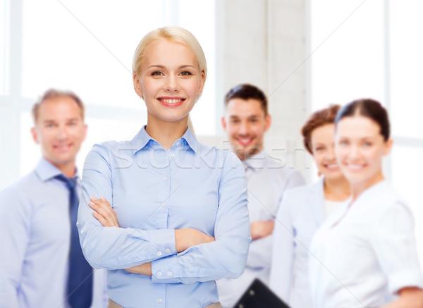Fiatal mosolyog üzletasszony karok üzlet oktatás Stock fotó © dolgachov