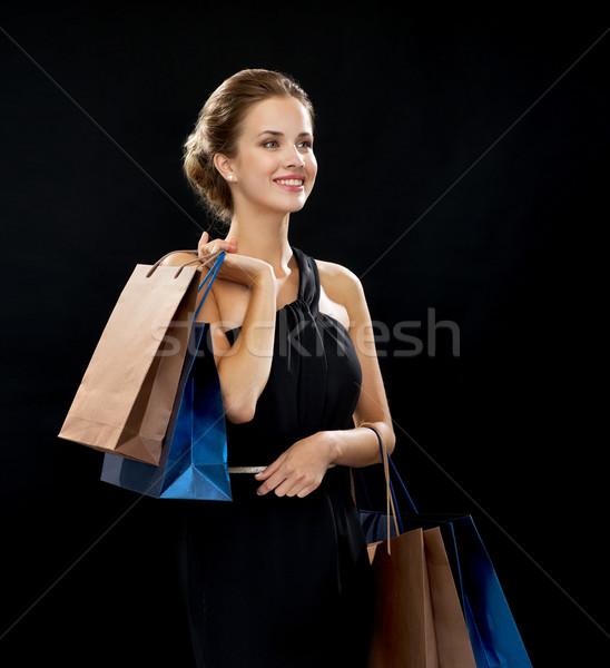 Stok fotoğraf: Gülümseyen · kadın · elbise · alışveriş · satış · hediyeler
