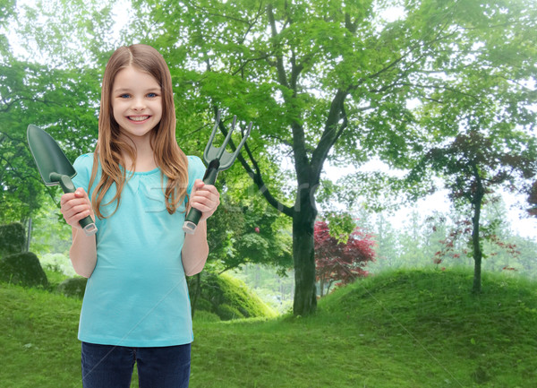 smiling little girl with rake and scoop Stock photo © dolgachov