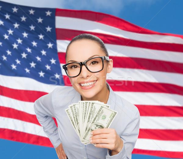 smiling businesswoman with dollar cash money Stock photo © dolgachov