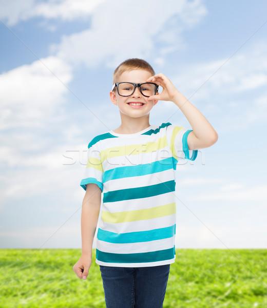 Mosolyog kicsi fiú szemüveg előrelátás oktatás Stock fotó © dolgachov
