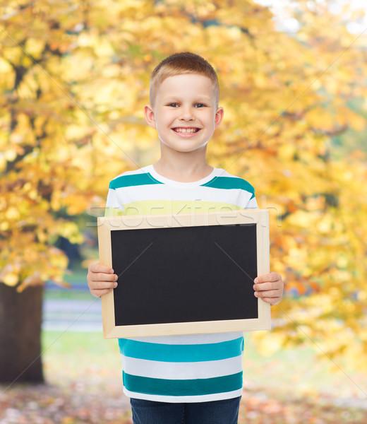 Foto d'archivio: Sorridere · piccolo · ragazzo · nero · lavagna