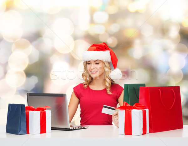 smiling woman with credit card and laptop Stock photo © dolgachov