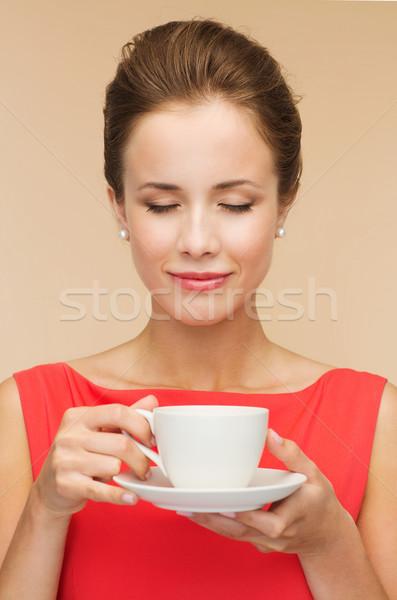Gülümseyen kadın kırmızı elbise fincan kahve boş mutluluk Stok fotoğraf © dolgachov
