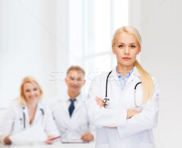 serious female doctor with stethoscope Stock photo © dolgachov
