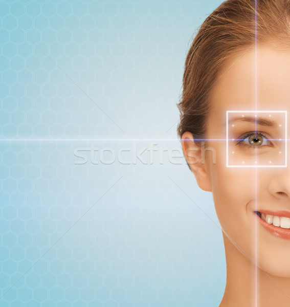 smiling young woman with laser light lines Stock photo © dolgachov