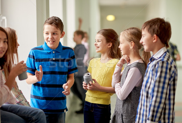 group of school kids with soda cans in corridor Stock photo © dolgachov