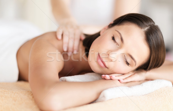 beautiful woman in spa salon getting massage Stock photo © dolgachov