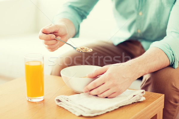 close up of man eating breakfast at home Stock photo © dolgachov