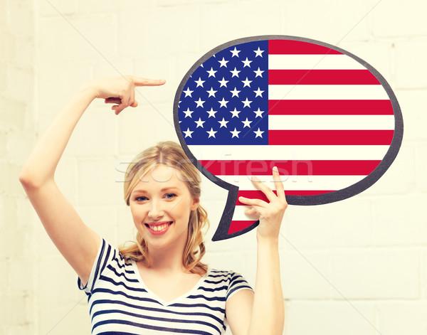 Mosolygó nő szöveg buborék amerikai zászló oktatás külföldi Stock fotó © dolgachov