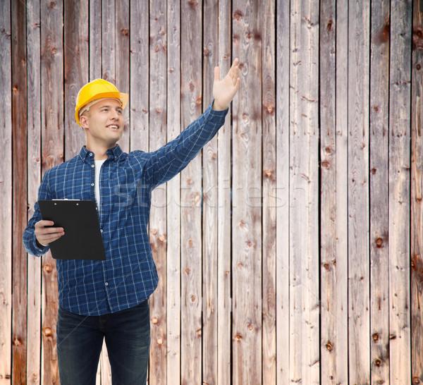 Mosolyog férfi építész sisak vágólap javítás Stock fotó © dolgachov