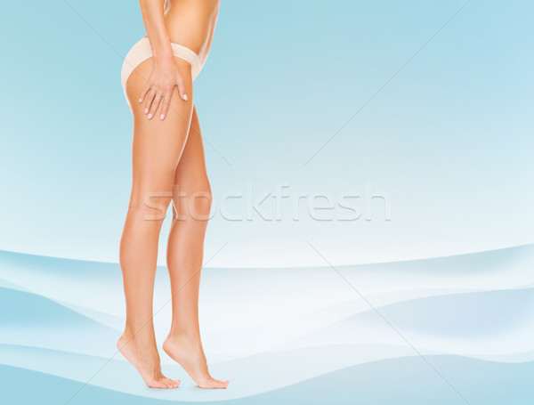 woman legs in cotton panties walking tiptoes Stock photo © dolgachov