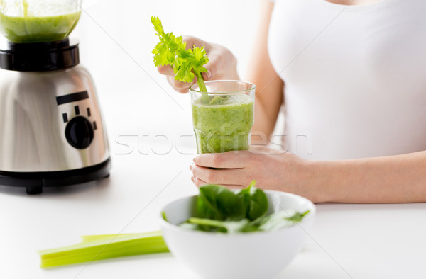 close up of woman with blender and green smoothie Stock photo © dolgachov