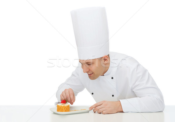happy male chef cook decorating dessert Stock photo © dolgachov