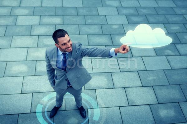 Sonriendo empresario nube proyección aire libre negocios Foto stock © dolgachov