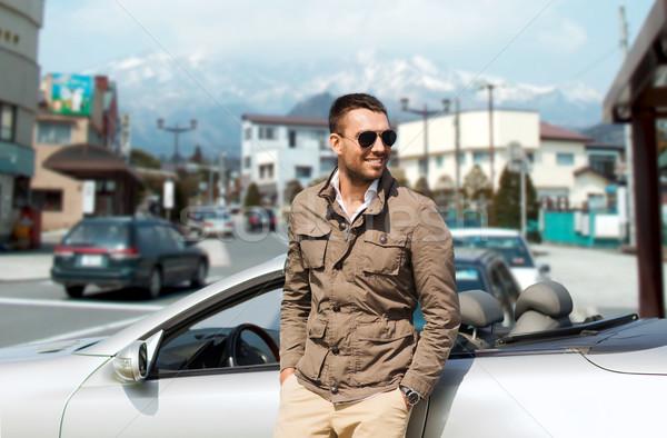 Feliz homem cabriolé carro cidade Japão Foto stock © dolgachov