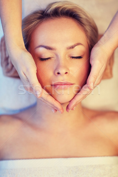 Stock photo: close up of woman having face massage in spa