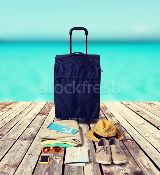 travel bag and personal stuff for vacation Stock photo © dolgachov