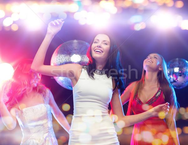 happy women dancing at night club Stock photo © dolgachov