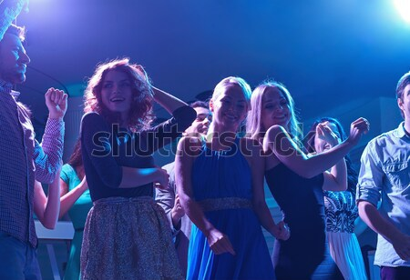 улыбаясь друзей танцы клуба вечеринка праздников Сток-фото © dolgachov