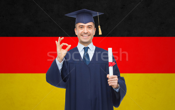 smiling adult student in mortarboard with diploma Stock photo © dolgachov
