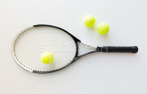 close up of tennis racket with balls Stock photo © dolgachov