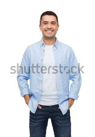 smiling man with hands in pockets Stock photo © dolgachov