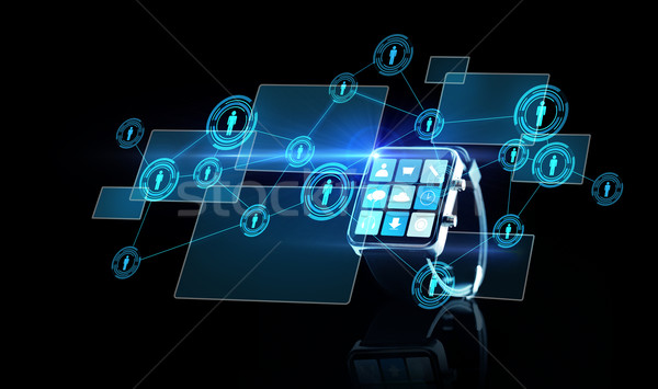 close up of smartwatch with app icons and contacts Stock photo © dolgachov