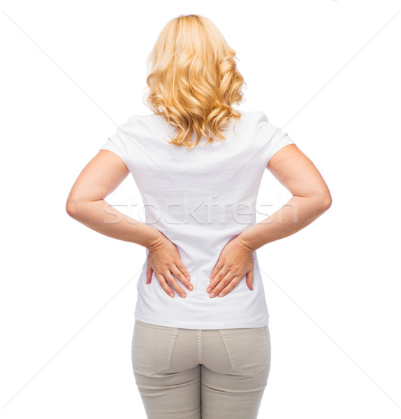 woman suffering from backache Stock photo © dolgachov