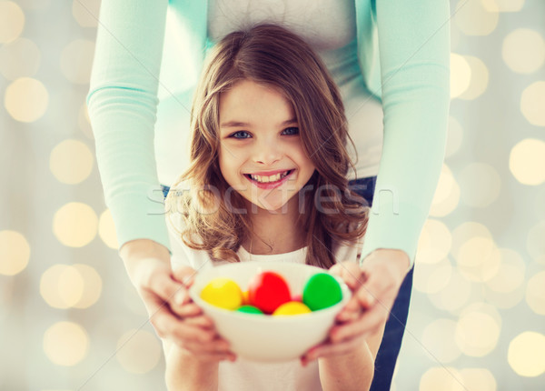 close up of happy family holding easter eggs Stock photo © dolgachov