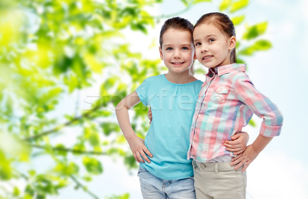 happy smiling little girls hugging Stock photo © dolgachov