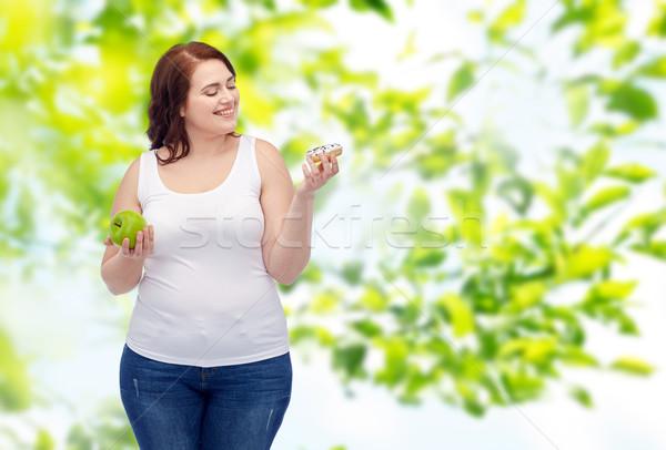 Szczęśliwy plus size kobieta jabłko pączek Zdjęcia stock © dolgachov