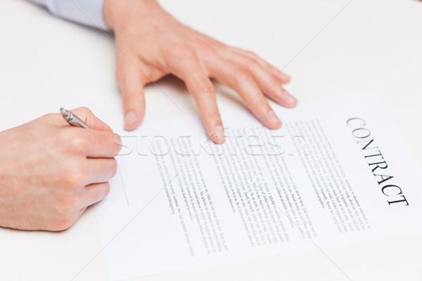 Közelkép férfi kezek aláírás szerződés irat Stock fotó © dolgachov
