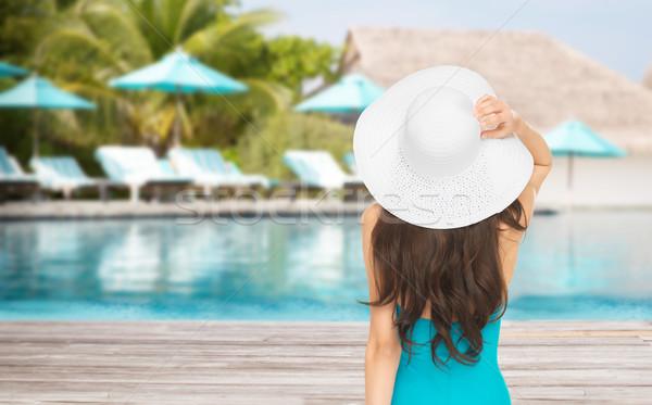 Femme maillot de bain Retour plage personnes Photo stock © dolgachov