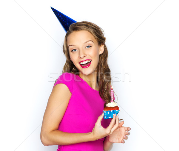 Stock photo: happy woman or teen girl with birthday cupcake