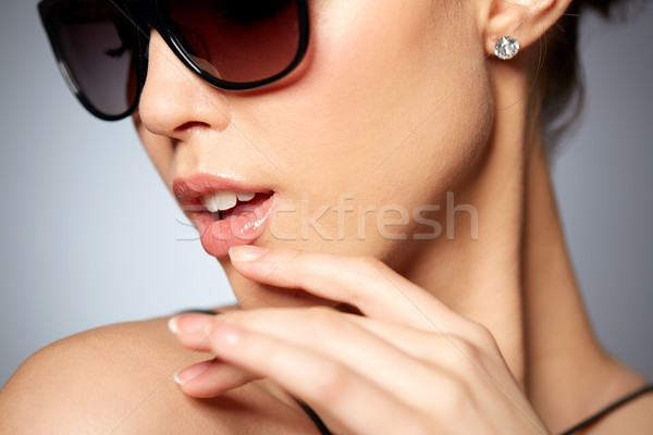 close up of beautiful woman in black sunglasses Stock photo © dolgachov