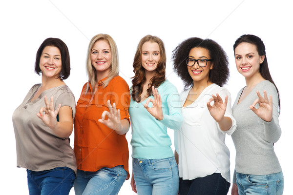 group of happy different size women showing ok Stock photo © dolgachov