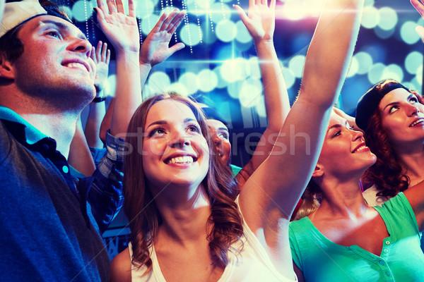 Gülen arkadaşlar konser kulüp parti tatil Stok fotoğraf © dolgachov