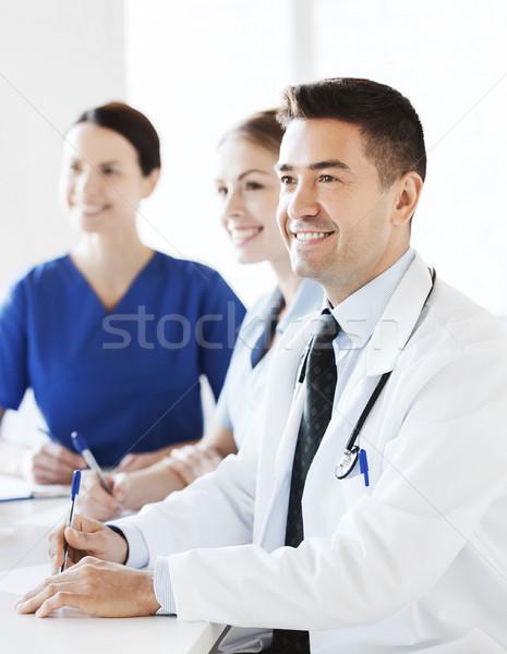 group of doctors on presentation at hospital Stock photo © dolgachov
