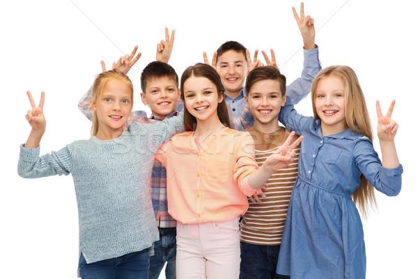 счастливым детей мира рукой знак детство Сток-фото © dolgachov