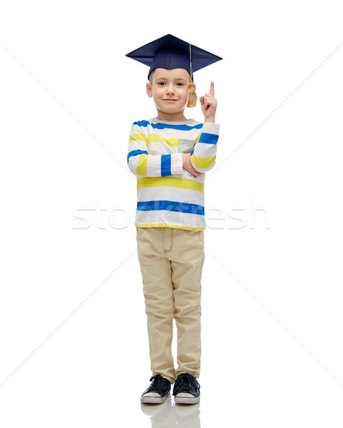happy boy in bachelor hat pointing finger up Stock photo © dolgachov
