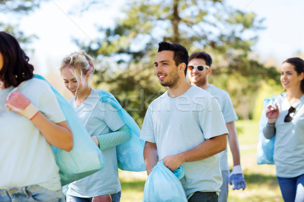 group of volunteers with garbage bags in park Stock photo © dolgachov