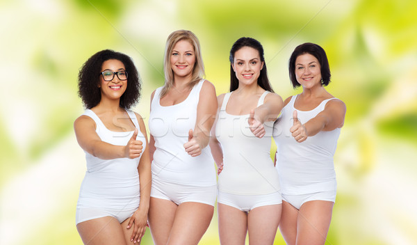 Stock photo: group of happy different women showing thumbs up
