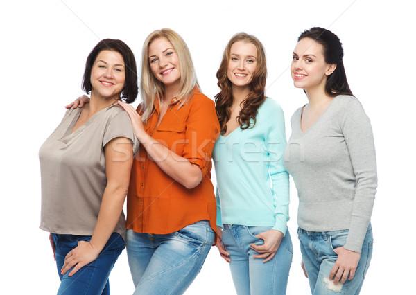 Csoport boldog különböző nők lezser ruházat Stock fotó © dolgachov