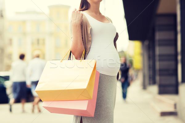 ストックフォト: 妊婦 · ショッピングバッグ · 街 · 妊娠 · 母性 · 人