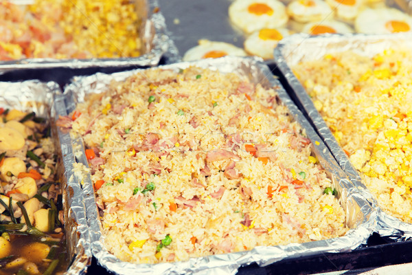 wok or pilaf dish at street market Stock photo © dolgachov