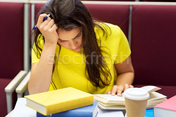 student girl with books and coffee on lecture Stock photo © dolgachov