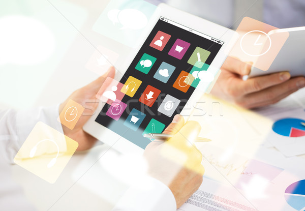 close up of hands with menu icons on tablet pc Stock photo © dolgachov