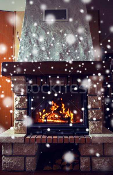 close up of burning fireplace with snow Stock photo © dolgachov