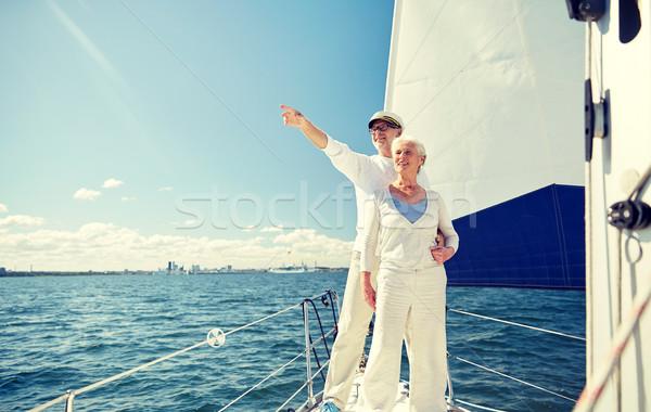 senior couple sailing on boat or yacht in sea Stock photo © dolgachov